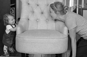 Nine month old playing peek a boo with mother Photo Halee Sherwood|CC